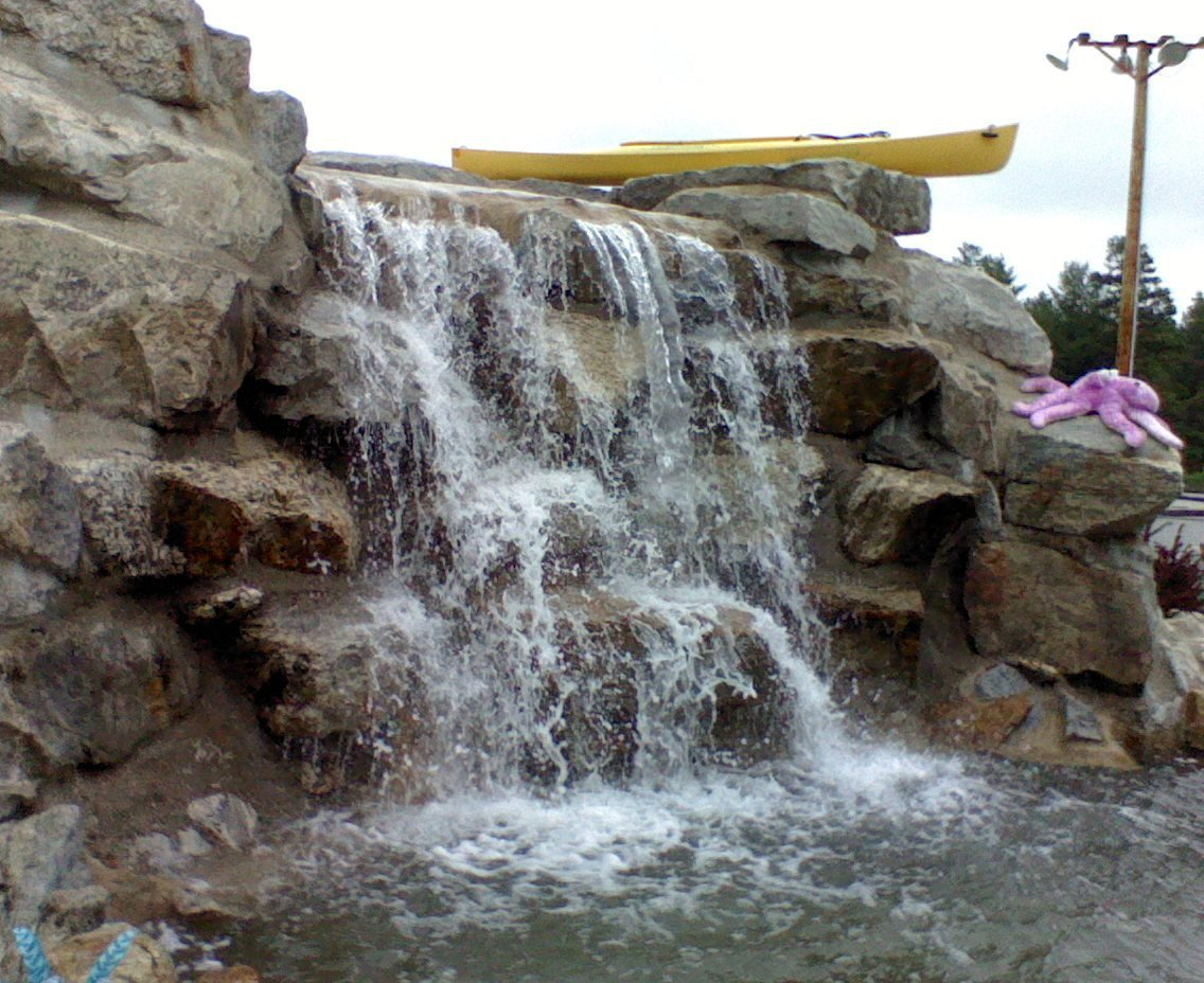 The main waterfall (as it sits today)  at White Lake Speedway Inc. family fun center.