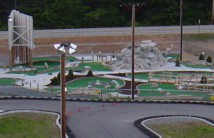 "A birds-eye view of the 18 hole ""Championship Grade"" miniature golf course @ White Lake Speedway Inc. family fun center."